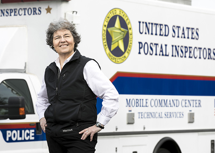 New grad with master's in biodefense helps protect the nation's mail